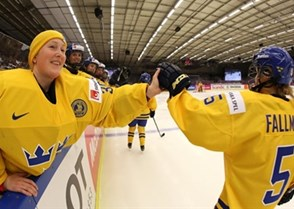 MALMO, SWEDEN - MARCH 28: Sweden's Kim Martin Hasson #30 and Johanna Fallman #5 celebrate at the bench after a first period goal against Japan during preliminary round action at the 2015 IIHF Ice Hockey Women's World Championship. (Photo by Andre Ringuette/HHOF-IIHF Images)