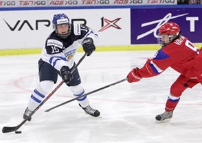 MALMO, SWEDEN - MARCH 28: Finland's Minttu Tuominen #15 looks for a pass with pressure from Russia's Alexandra Vafina #9 during preliminary round action at the 2015 IIHF Ice Hockey Women's World Championship. (Photo by Francois Laplante/HHOF-IIHF Images)