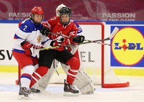 MALMO, SWEDEN - MARCH 29: Canada's Caroline Ouellette #13 battles for position with Russia's Angelina Goncharenko #2 while Yulia Leskina #31 looks on during preliminary round action at the 2015 IIHF Ice Hockey Women's World Championship. (Photo by Andre Ringuette/HHOF-IIHF Images)