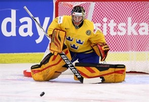 MALMO, SWEDEN - APRIL 1: Sweden's Sara Grahn #1 goes down to play the puck during quarterfinal round action against Russia at the 2015 IIHF Ice Hockey Women's World Championship. (Photo by Andre Ringuette/HHOF-IIHF Images)